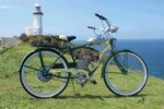 Bike fitted with motor parked at lighthouse